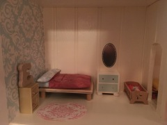Parents room: homemade bed, dresser, mirror and rug